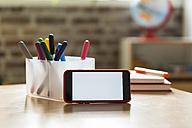 Smartphone on wooden table in children's room - MFF001407