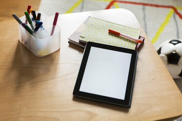 Tablet computer on wooden table in children's room - MFF001408