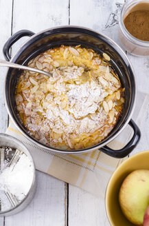 Enamel cooking pot of apple souffle with almonds and icing sugar - ODF001090