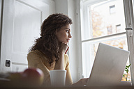 Young woman at home using laptop - RBF002264