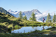 Austria, Salzburg State, Young woman hiking in mountains - HHF005079