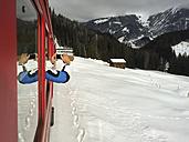Switzerland, Arosa, man taking smart phone picture - DRF001255
