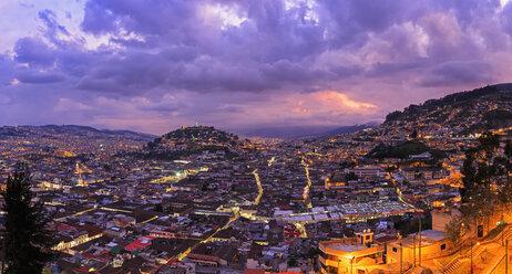 Ecuador, Quito, cityscape with El Panecillo at sunset - FOF007605