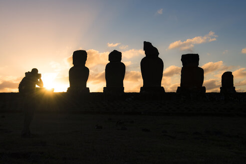 Chile, Easter Island, Man taking pictures of Moais at sunset, Ahu Tahai Complex, Rapa Nui National Park - GEMF000202