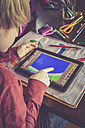 Boy using digital tablet for drawing - SARF001317