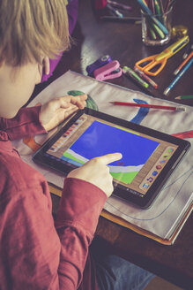 Boy using digital tablet for drawing - SARF001317