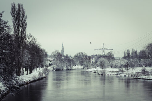 Germany, Landshut, Isar River in winter with spire of St Martin's Church - SARF001318