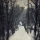Germany, near Wuppertal, man walking on forest path in winter, textured effect - DWI000425