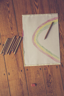 Sketch block and colored pencils on timber floor - LVF002727