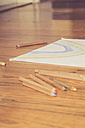 Sketch block and colored pencils on timber floor - LVF002729