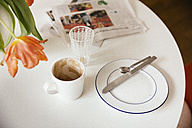 Breakfast table with newspaper after using - MFF001458