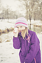 Little girl with snowball - SARF001320