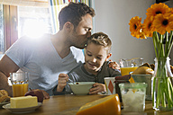 Father and son having breakfast together - PDF000729