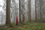 Austria, woman standing alone in the wood - WWF003784