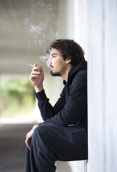 Young man smoking cigarette - WWF003725