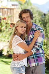 Portrait of hugging young couple in a garden - WWF003852