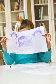 Little girl showing drawing - LVF002793