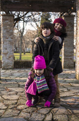 Three children in a park on a winter day - MGOF000054