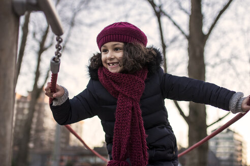 Portrait of a happy little girl on a playground on a winter day - MGOF000069