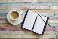 Cup of coffee and opened notebook - SARF001328