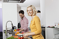 Couple cooking in kitchen - RBF002369