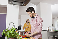 Couple cooking in kitchen - RBF002372