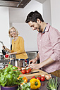Couple cooking in kitchen - RBF002375
