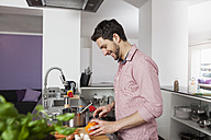 Man cooking in kitchen - RBF002378