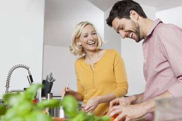 Happy couple cooking in kitchen - RBF002381