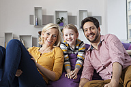 Portrait of happy mother, father and daughter at home - RBF002399