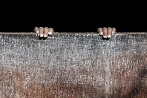 Nepal, Khumbu, Child hands on door - ALR000010