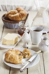 Breakfast with croissant, egg, coffee, honey and butter - SBDF001611