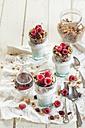 Homemade glutenfree nut granola, raspberries, Greek yogurt and maple syrup - SBDF001616