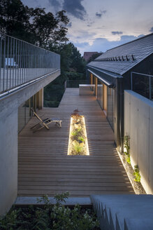 One family house, wooden terrace in the evening - DISF001161