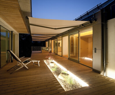 One family house, wooden terrace with awnings in the evening - DISF001167