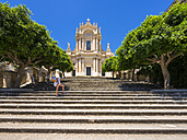 Italy, Sicily, Modica, Woman looking at San Giovanni church, UNESCO World heritage site - AMF003754