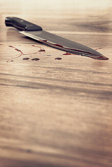 Blood stained knife on wooden floor - MID000056