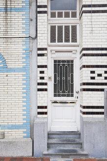 Belgium, Flanders, Blankenberge, entry door of an old house with tiled facade - GW004484