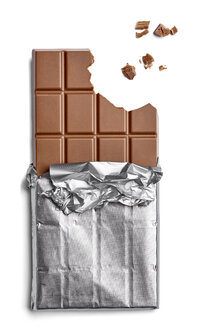 Chocolate bar and crumbs on white background - RAMF000037