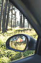 Bulgaria, Car in the woods, reflection of tent in the wing mirror - DEG000220