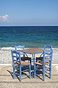 Greece, table and chairs of taverna at seashore - DEGF000245