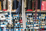 Lace and cardboard boxes with buttons in a shop - DEGF000259