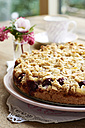 Chocolate chip cherry cake with an almond streusel topping on cake plate - HAWF000633