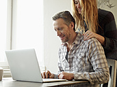 Germany, Cologne, Mature man and adult daughter surfing the web - RHF000481