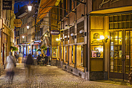 Switzerland, Vevey, Rue du Lac, restaurants and shops at night - WD002941