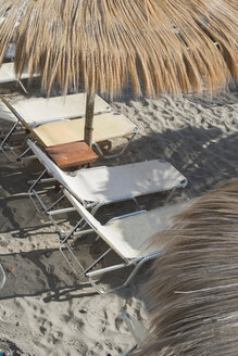 Greece, straw umbrellas and beach chairs - DEGF000169