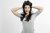 Portrait of excited young woman - GDF000673