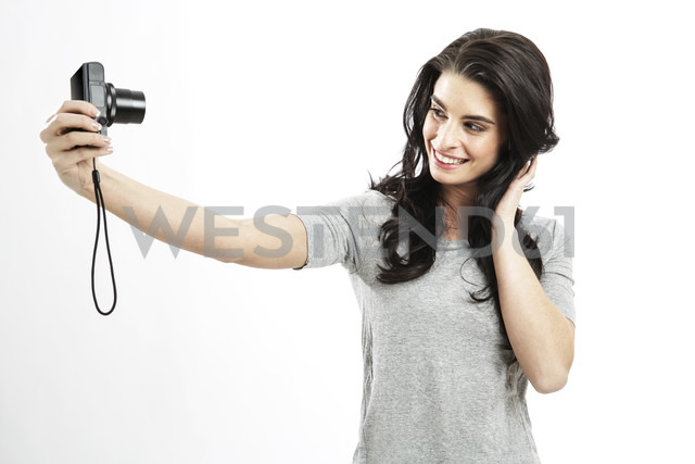 Portrait of young woman taking a selfie with camera - GDF000678