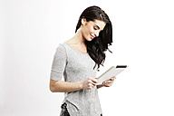 Smiling young woman with digital tablet - GDF000683