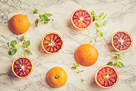 Blood orange and mint leaves on marble - SARF001353